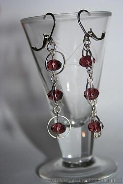 OR078 Swarovski rings: Örhängen med lila swarovski pärlor samt ringar...65:- 35:-