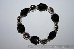 AR189 Metal coin: Elastiskt armband med svarta glaspärlor...79:- 59:-