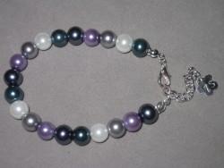 AR103 5 color arm: Armband med pärlor i olika färger...70:- SÅLD För att se en större bild, klicka på denna länk.