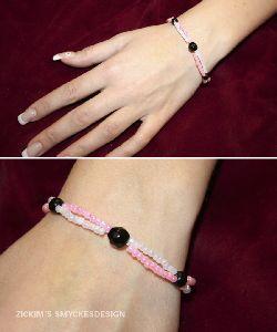 SE012 Tworow: 2 radigt armband i rosa och vitt + tillhörande örhängen...70:-SÅLD