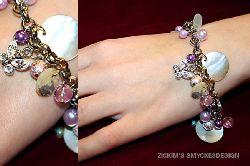 AR004 Berlock pink: Berlockarmband med rosa/lila färger...170:- SÅLD