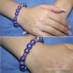 AR014 Purplepill: Armband med elastiskt band med lila drizzle pärlor...80:- SÅLD