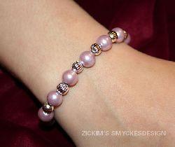AR016 Silverdust: armband med elastiskt band med lila och silver pärlor...60:- SÅLD