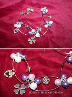 AR045 Link pearl: Armband med ovala länkar samt olika pärlor och berlocker...85:-SÅLD  För att se en större bild, klicka på denna länk.