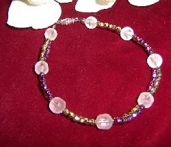 AR031 Frosty 2row: 2 radigt armband i lila och guld med frostade pärlor...69:- SÅLD För att se en större bild, klicka på denna länk.