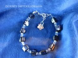 AR054 Blackshell: Armband med svarta snäckskals pärlor...75:- SÅLD
