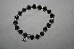AR137 Black facett: Elastiskt armband med svarta facetterade pärlor...90:- SÅLD För att se en större bild, klicka på denna länk.