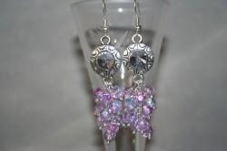 OR063 Crystal inca: Örhängen med lila facetterade glaspärlor och strass mellandelar...79:- 45:- För att se en större bild, klicka på denna länk.