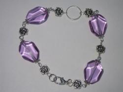 AR108 Purple rose: Armband med lila glasbumlingar...75:- 45:-För att se en större bild, klicka på denna länk.