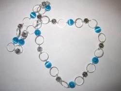 HA070 Little blue: Halsband med små blåa cateye pärlor och ringar...95:- SÅLD  För att se en större bild, klicka på denna länk.